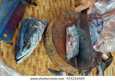 dried salty  mackerel fish is cutting in pieces