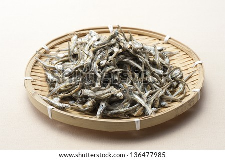 Dried sardine on bamboo basket