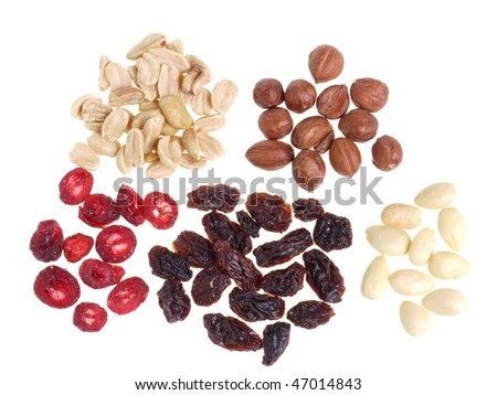 Dried sliced cranberry, raisins, hazelnuts, groundnuts and almonds over white background - stock photo