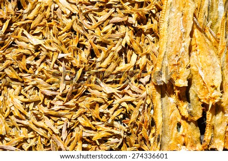 Dried small fish on asian fish market for background - stock photo