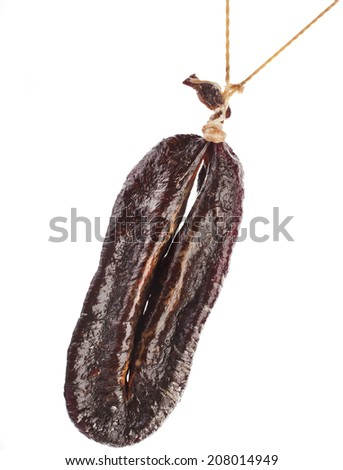 dried solid sausages Turkic sudzhuk hanging  isolated on white background - stock photo