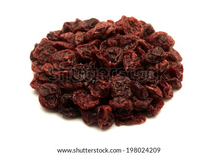 Dried sour cherries on a white background - stock photo