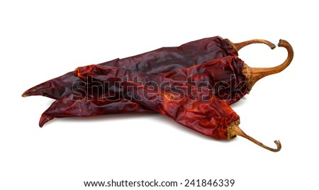 Dried Spicy Chili Peppers isolated on white background - stock photo