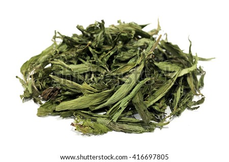Dried stevia leaves on a white background