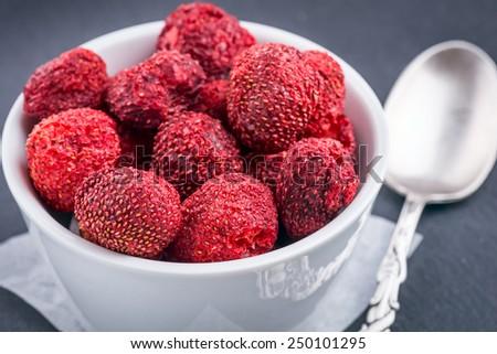 Dried Strawberry Dried Strawberry on black background - stock photo