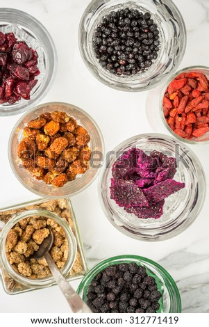 Dried superfruits in glasses - stock photo