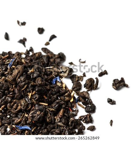 Dried Tea leaves isolated on a white background close up with copyspace  - stock photo