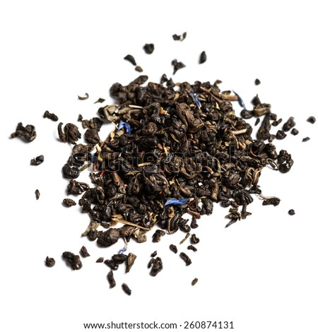 Dried  Tea leaves isolated on a white background close up with copyspace for text. - stock photo