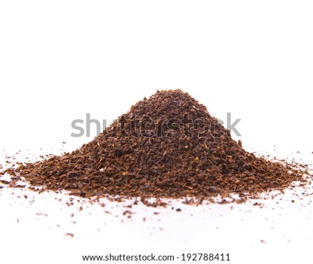 Dried tea leaves on a white background