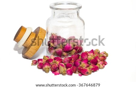 Dried tea rose flowers in the bottle on the white background isolated - stock photo