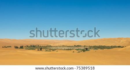 Dried up Lake Mandara - Idyllic oasis in the Awbari Sand Sea, Sahara Desert, Libya - stock photo