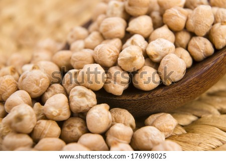 dried white chickpeas ceci on the wooden spoon - stock photo