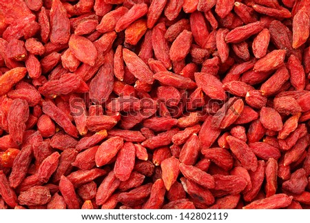 Dried wolfberry fruit background - stock photo