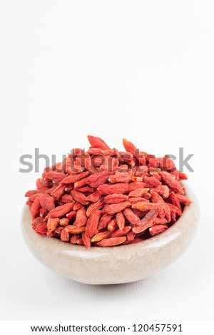 dried wolfberry fruit in bowl on white background - stock photo