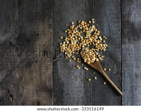 Dried yellow split peas with a spoon  - stock photo