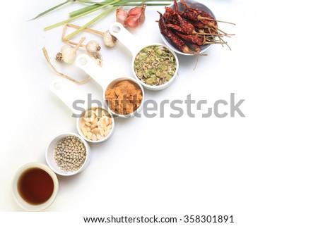 Dries chili, pepper,lemongrass,garlic,Coconut sugar and fish sauce, Thai herbs on white background. - stock photo