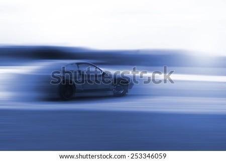 drift car motion blur in blue colour - stock photo
