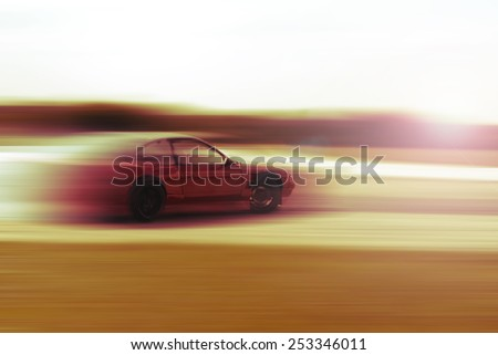 drift car motion blur sunrise or sunset - stock photo