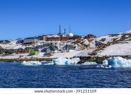Drifting icebergs along Nuuk shores, Greenlandic capital Nuuk - stock photo