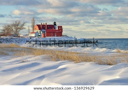 Drifting Winter snow at Lake Michigan Point Betsie Lighthouse, USA - stock photo