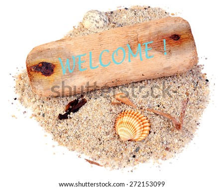 """Driftwood with text """"welcome!"""" on sand and sea shells isolated over white background - stock photo"""