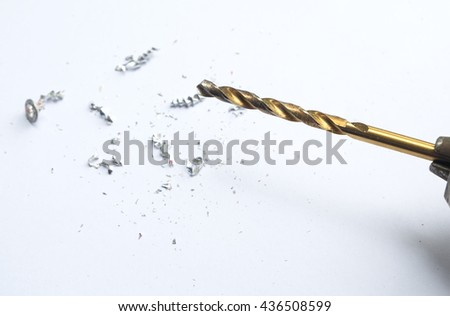 Drill,drill bits and Scrap metal on the white background - Golden twist drill bit  - Metal Shavings / Swarf - stock photo