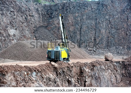 Drill equipment in a open pit mine. mining industry. - stock photo