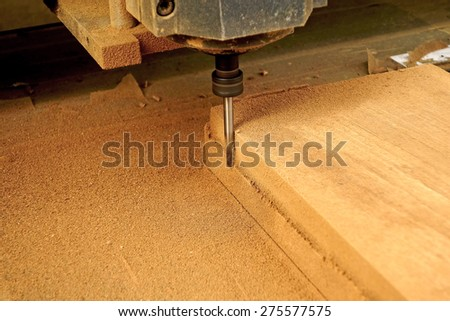 drill machine drilling a wood board - stock photo