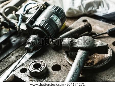 Drill machine, hammer and some mechanic tools - stock photo