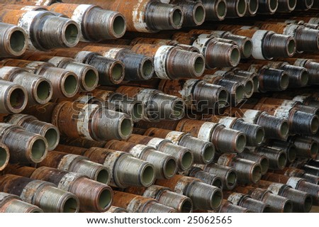 Drill Pipe Stacked on Pipe Deck - stock photo