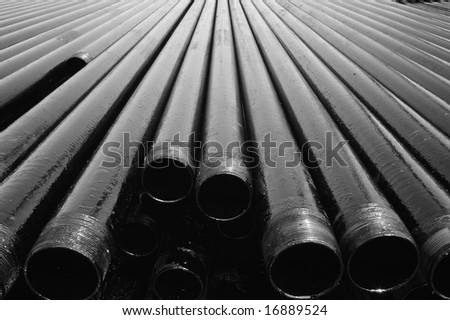 Drill pipes with petroleum - stock photo