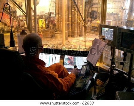 Driller's console and view of drill floor. Offshore oil rig in the North Sea