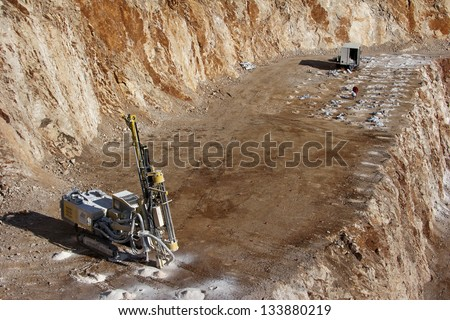 Drilling holes for demolition in a rock quarry near Split, town in Croatia - stock photo