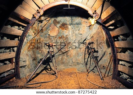 Drilling in mine with hand tools - stock photo