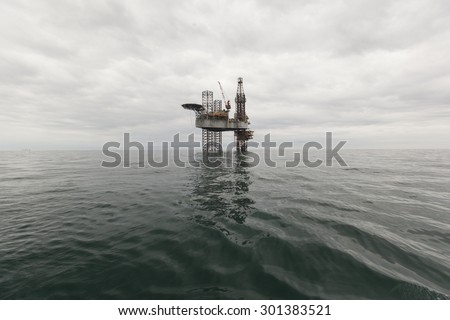 Drilling rig at cloudy day