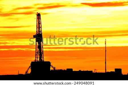 Drilling rig during the sunset - stock photo