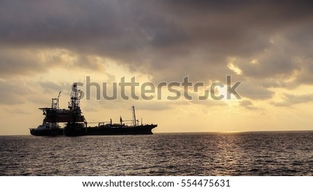 Drilling rig in the evening