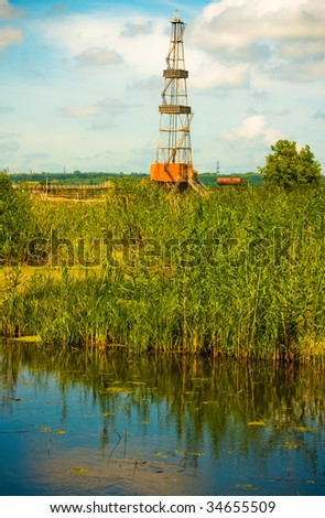 Drilling rig in the natural landscape - stock photo