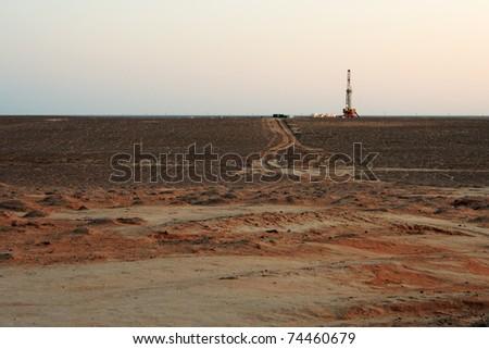 Drilling sunset. - stock photo