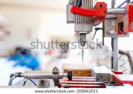drilling tool in production factory, manufacturing equipment and machinery - stock photo