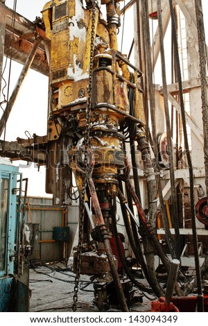 Drilling tower inside with crab for drilling well - stock photo