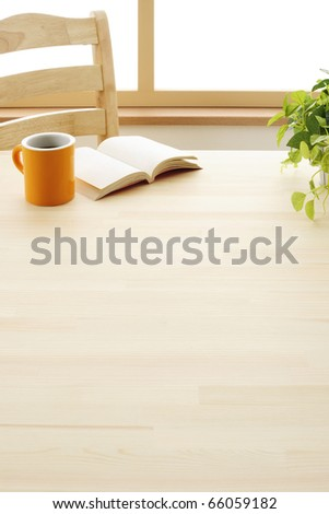 Drink a cup of coffee reading book - stock photo