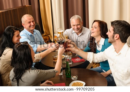 Drink after work business people toasting at restaurant have fun - stock photo