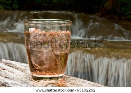 drink before waterfall - stock photo