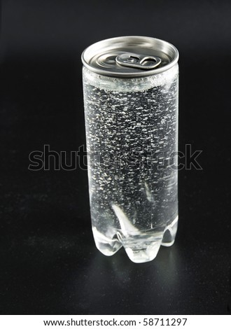 drink can with water droplets on black background - stock photo