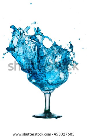 Drink Cocktail blue. Splash out of glass on a white background. - stock photo