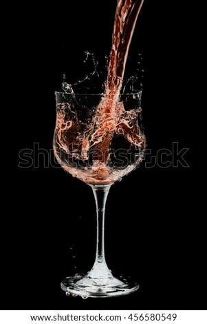 Drink cocktail glass splash out on a black background.  - stock photo