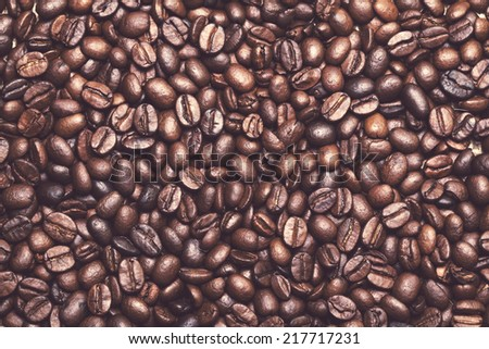 Drink, energy. Heap of coffee beans on the table - stock photo