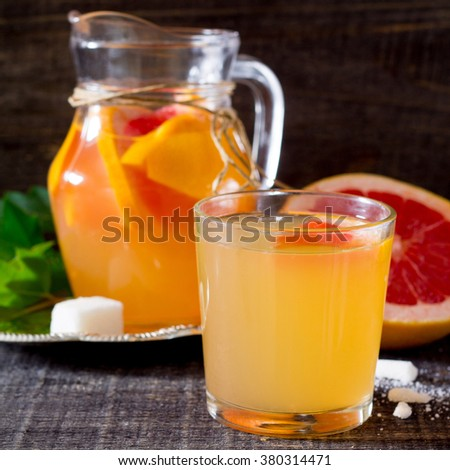 Drink fresh grapefruit on a wooden table