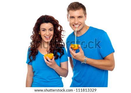 Drink healthy, stay healthy. Attractive couple drinking fresh orange juice - stock photo